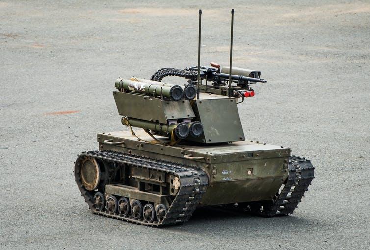 Robot tank on road.